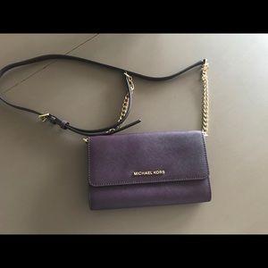 Purple cross body purse.
